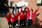 West Kidlington Primary School head Simon Isherwood celebrates the school's Ofsted rating. Pictured with reception pupils Summer Masters and Mustafa Al Ashkar, Year 2s Lucy White and Charlie Harris and Year 5s Jayden Buckingham and Alisa Maumenko. Pic