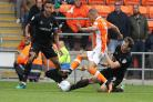 Mike Williamson (right) makes a tackle against Blackpool last weekend  Picture: Richard Parkes