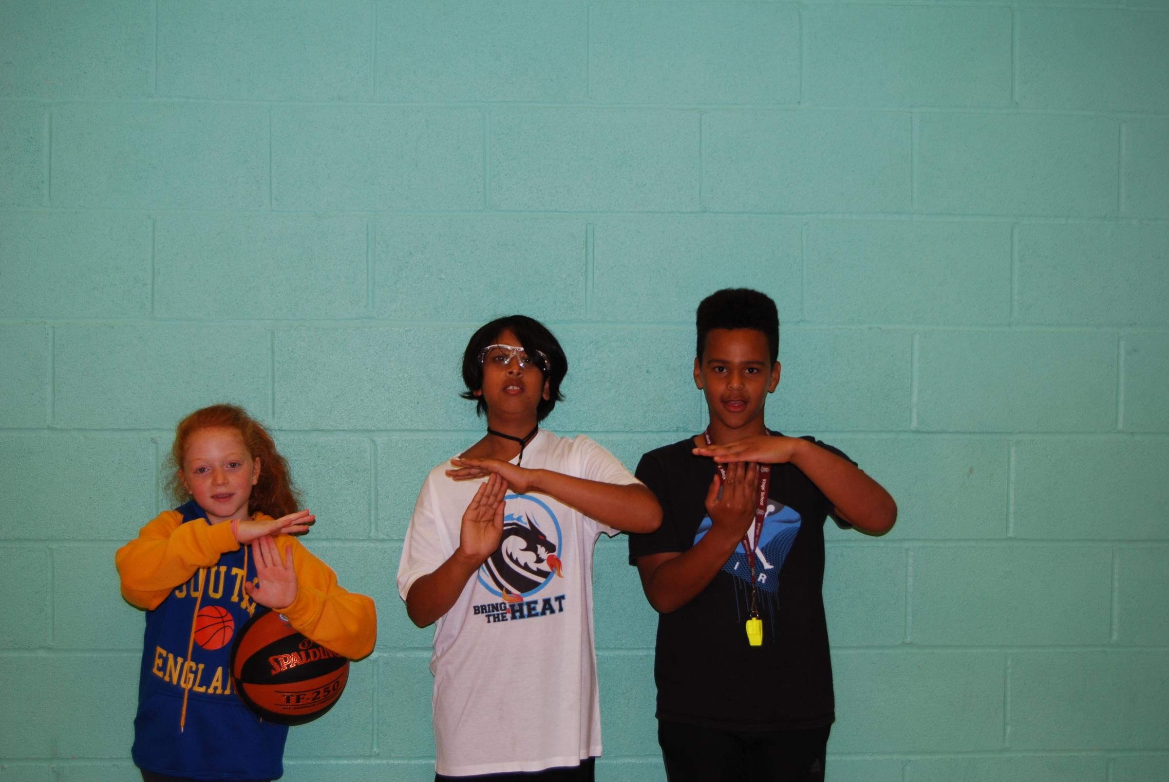 LEARNING THE SIGNALS: Tilly Goddard, LK Mahalingham and Malachi Owusu have qualified as refs aged 11
