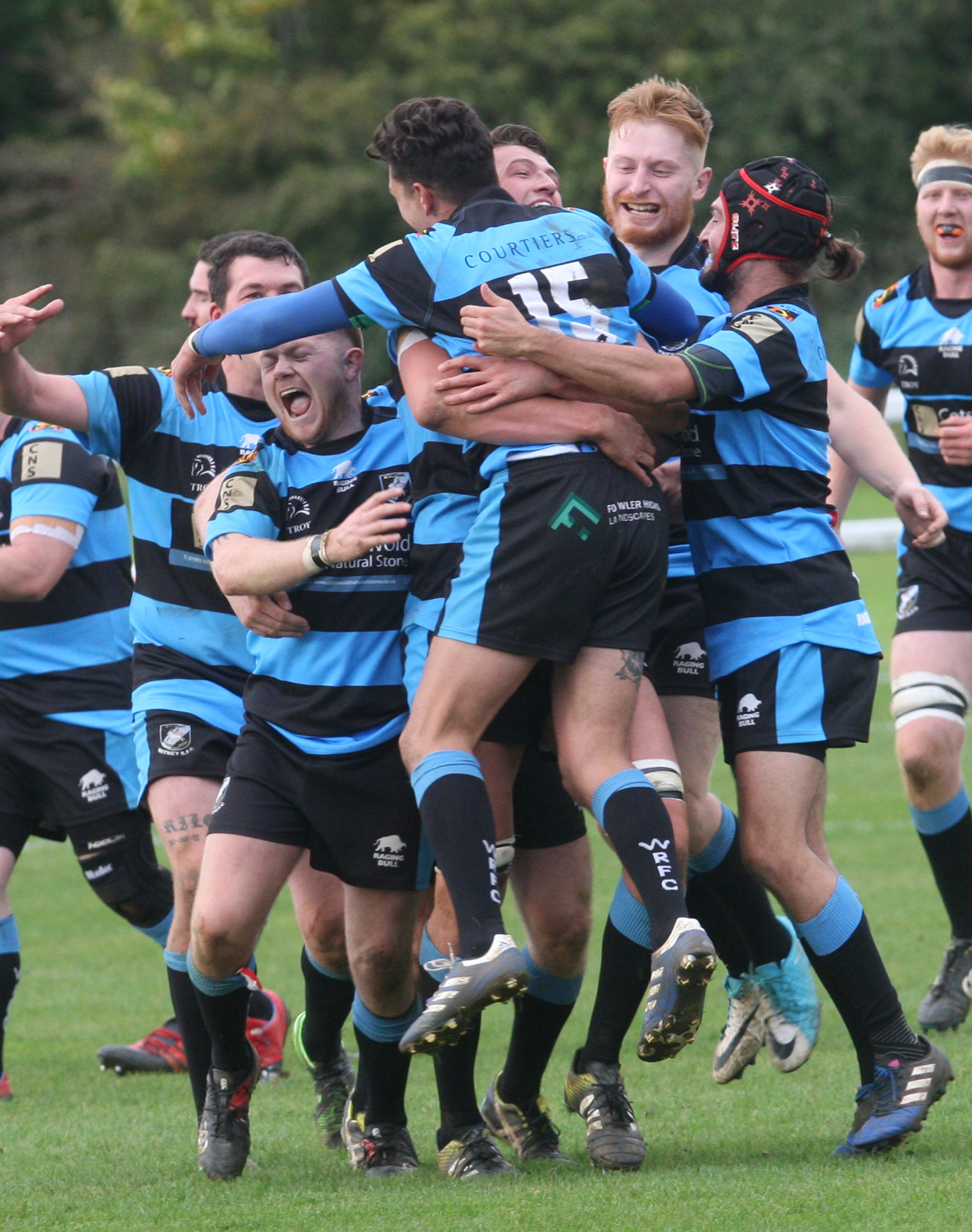 ELATION: Witney's players embrace Arron Lambourne (15) after the full back converted Jack Birks's last-gasp try to earn his side a 27-26 victory over Salisbury in South West 1 East Picture: Steve Wheeler