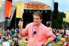 Director Hugh Phillimore raises a glass  to celebrate the last of his 14 festivals on the first day of the Cornbury Festival .Picture: Ric Mellis.7/7/2017.