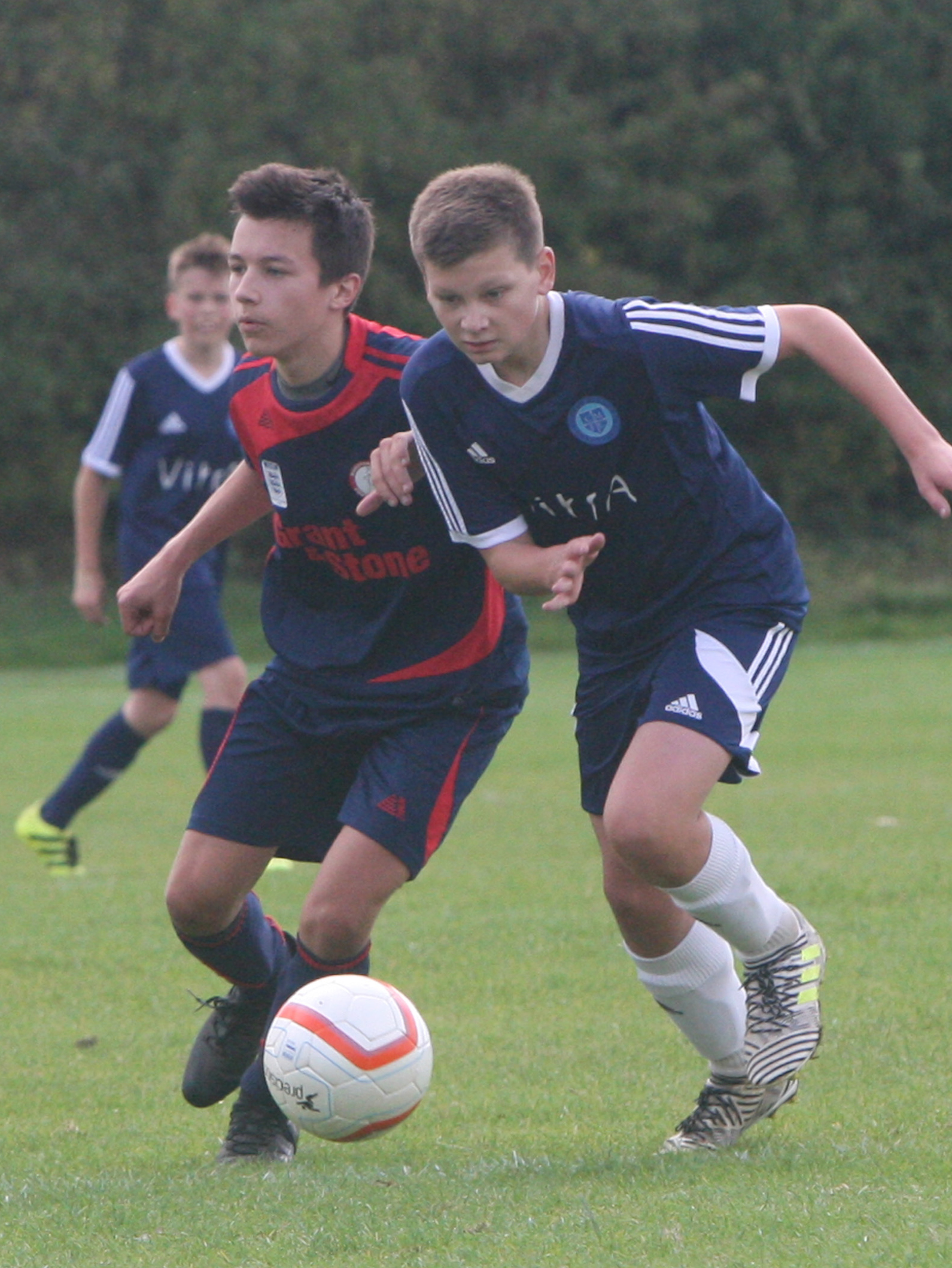 TRACKING BACK: Marston Saints' Matthew Hardecoeur Wilks (left) races to try to stop Jack Easton during his side's 1-0 win over Cumnor in the Under 15 C League Picture: Steve Wheeler