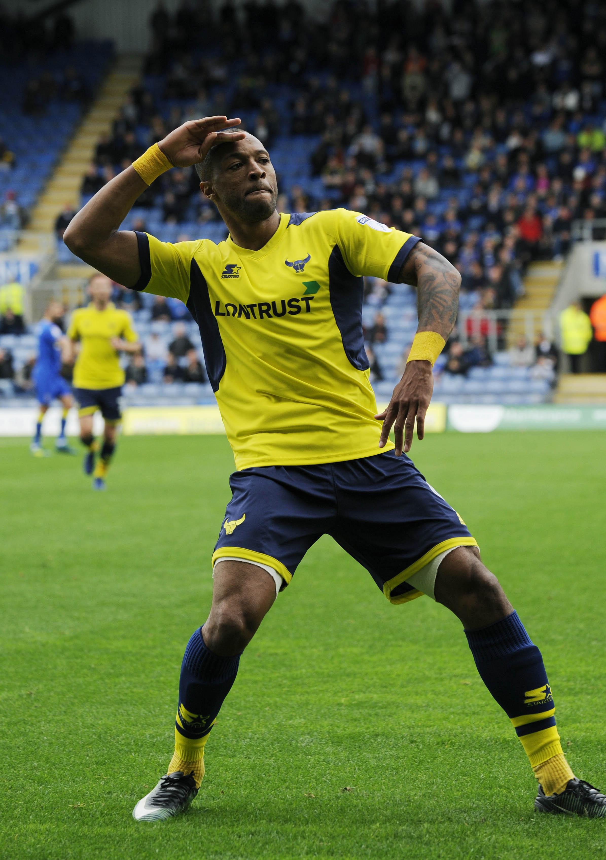 IN FORM: Wes Thomas celebrates his goal against Wimbledon