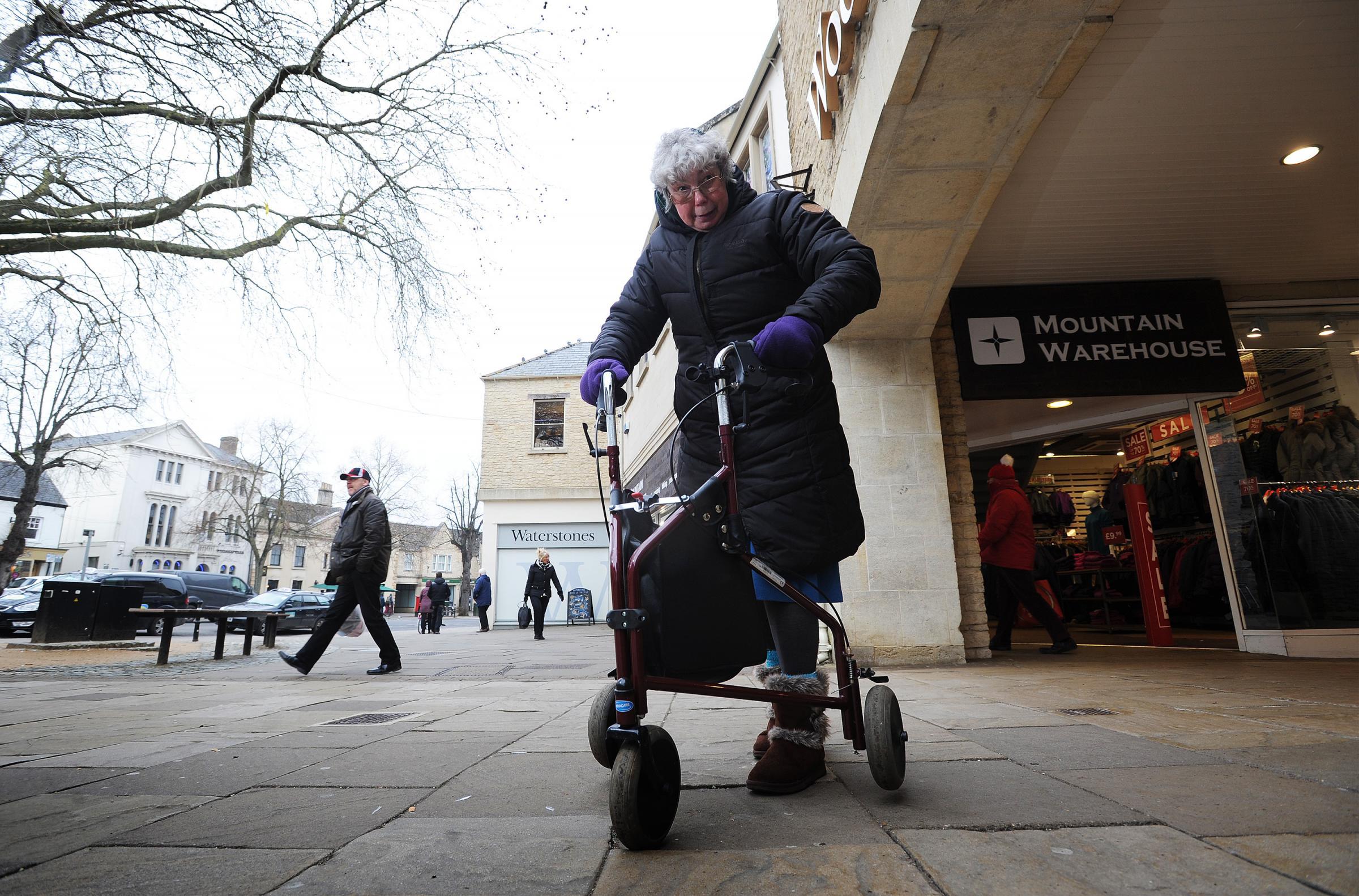 Dorothy Holloway, 68, broke her arm after tripping on uneven paving in Witney in 2015. She was only saved from another fall recently when two passers-by sprang into action. She is pictured is the Market Square with uneven paving stones some of which are s