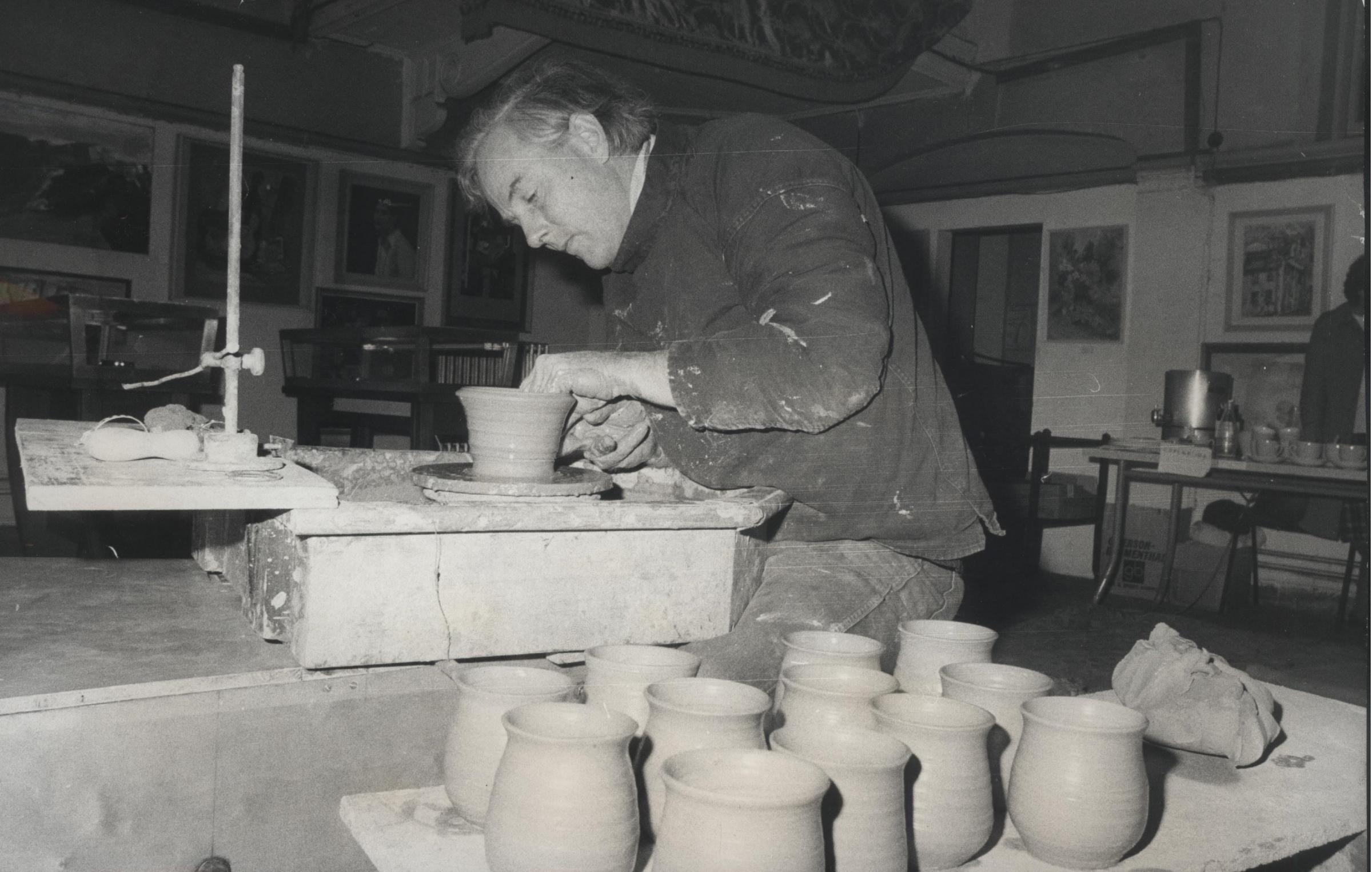 Reg Mills working at his pottery wheel.