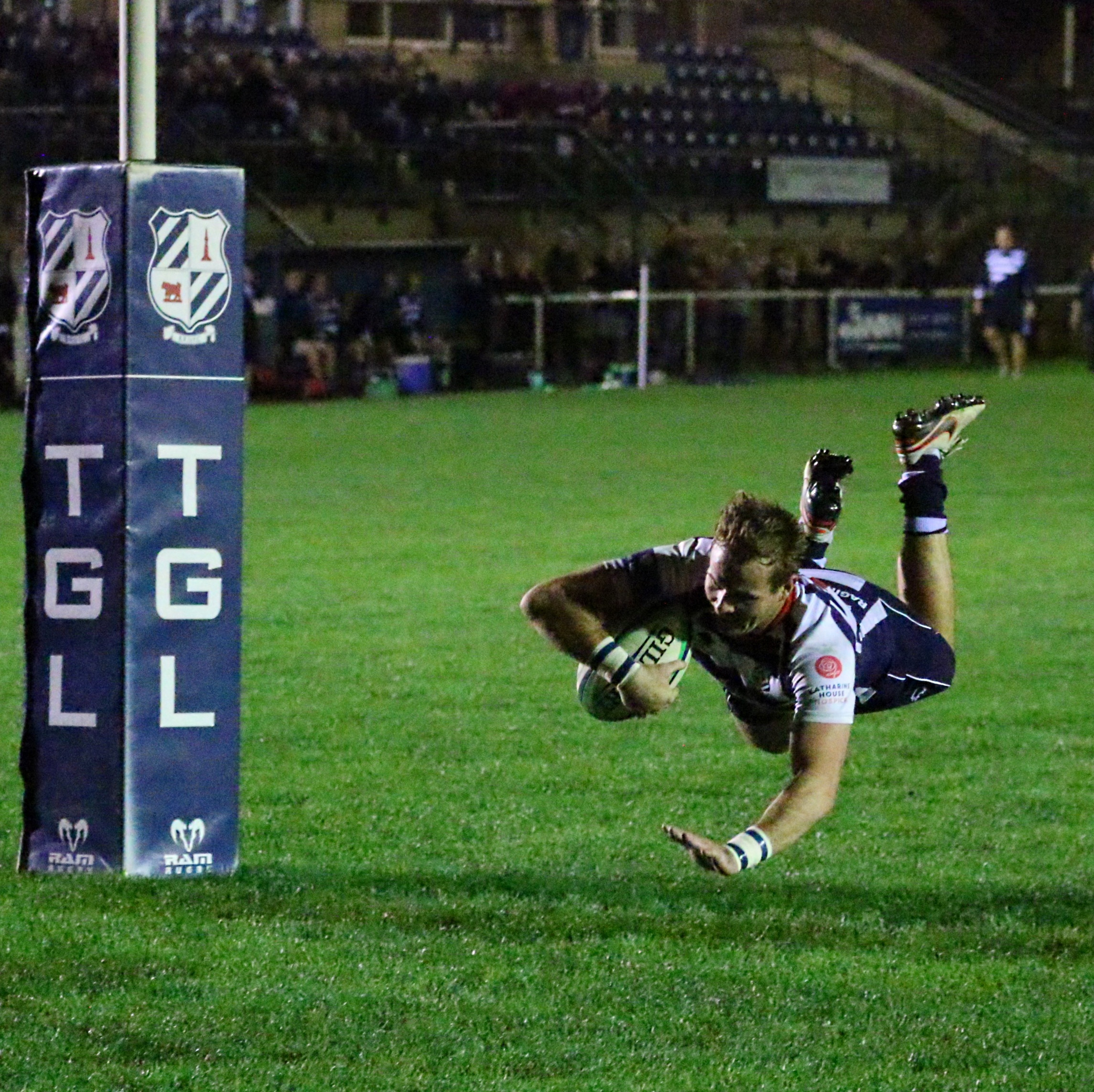 OFF THE GROUND: Banbury winger Tommy Gray dives over for a try during his side's 57-13 win over OxfordBrookes University in the Oxfordshire Cup Picture: Simon Grieve