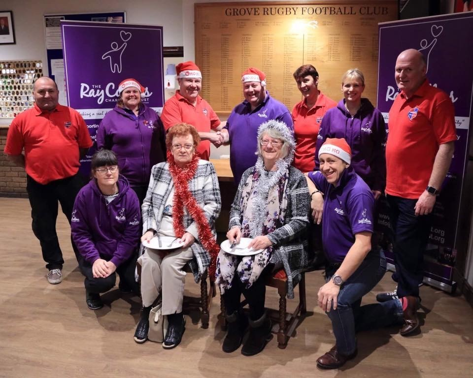Ray Collins - back, centre, in purple - with the team from Grove Rugby Club and two of his regulars at Christmas Dinner