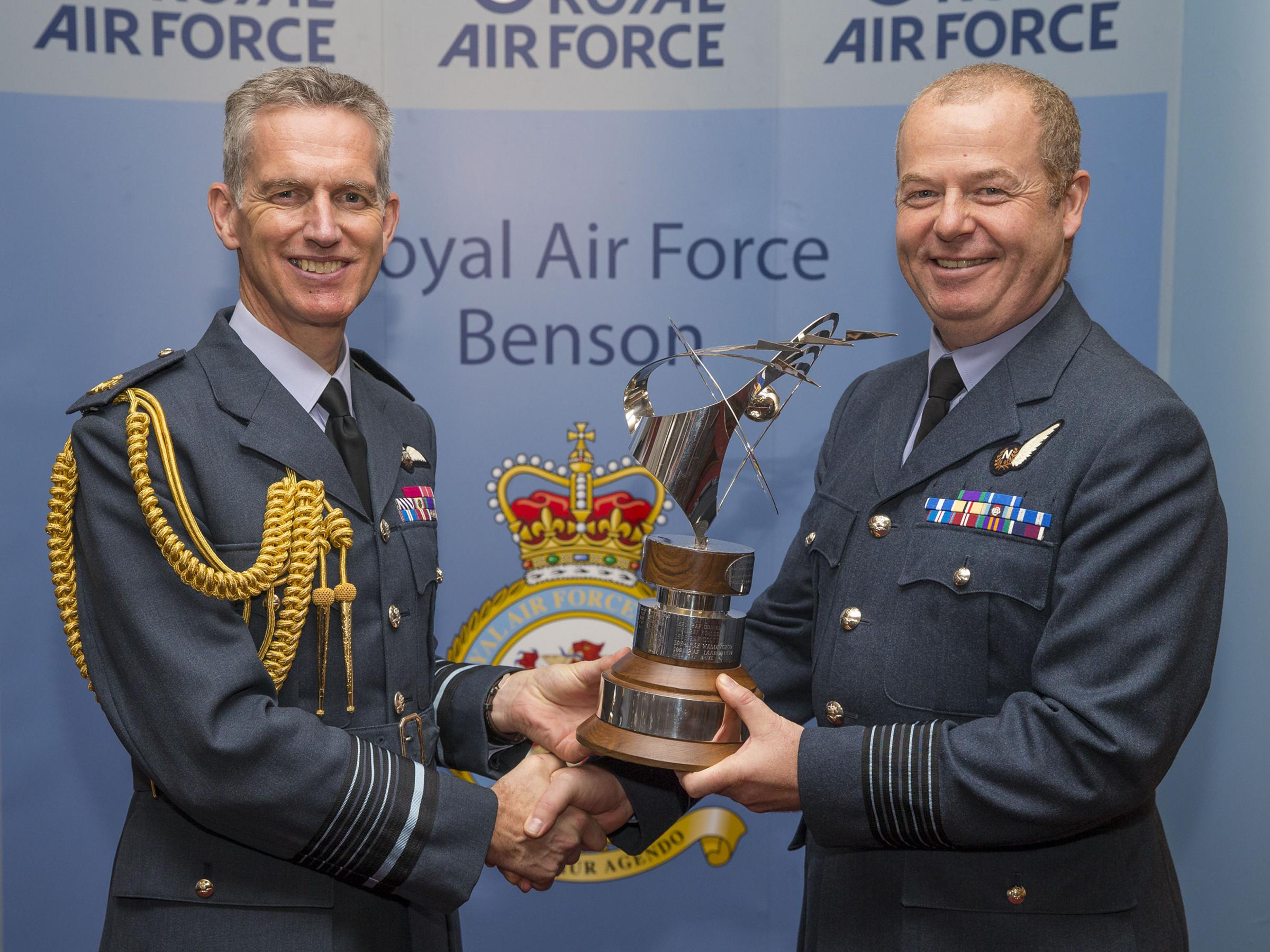 Chief of the Air Staff, Air Chief Marshal Sir Stephen Hillier, presents RAF Benson Station Commander, Group Captain Hamish Cormack, with the prestigious Stainforth Trophy on Tuesday, November 14, 2017. Picture: Senior aircraftman (SAC) Amy Lupton.
