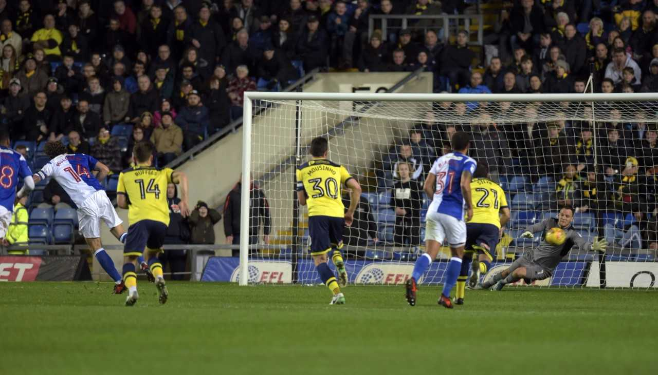 Charlie Mulgrew (left) hammers in the penalty to put Rovers 3-0 up after only 22 minutes  Picture: David Fleming