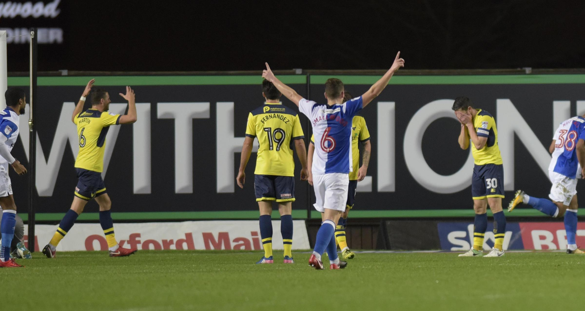 Oxford United captain John Mousinho (right) and centre back partner Aaron Martin (left) show their dismay at conceding a fourth goal against Blackburn Rovers last night. Picture: David Fleming