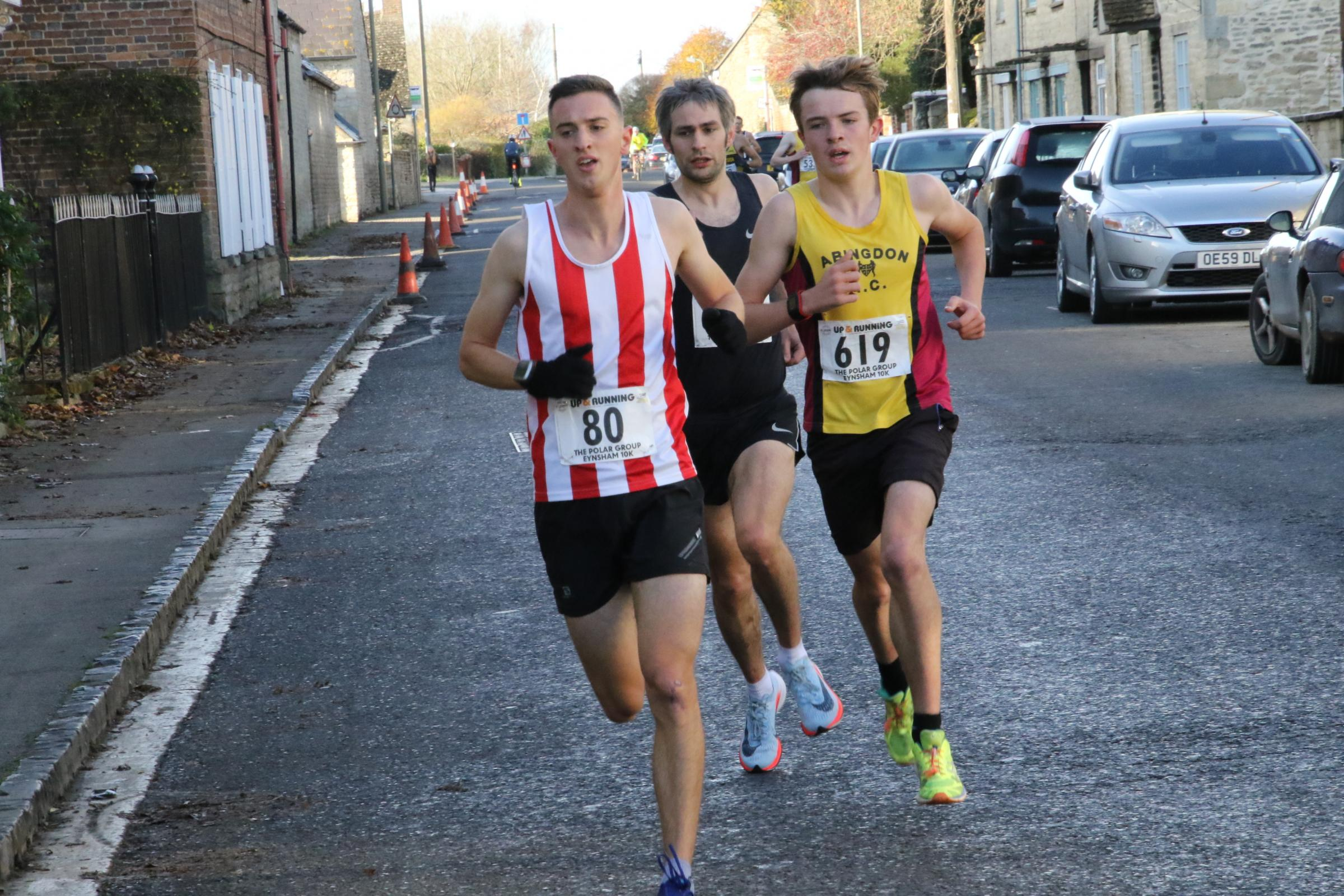 CLOSE: Matthieu Marshall (80) leads Abingdon's Jack Shayler (619) as the pair battled for the lead at the Eynsham 10k Picture: Barry Cornelius