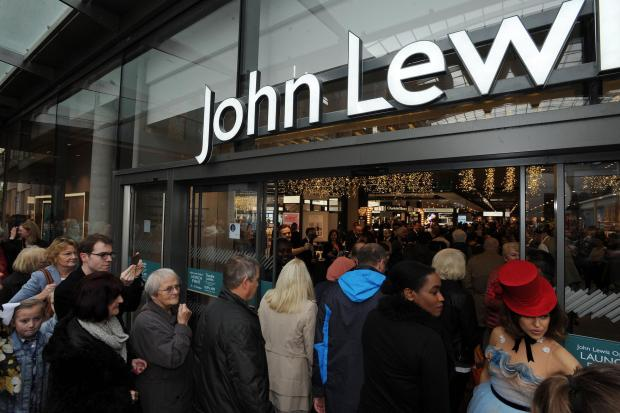 Oxford Mail: Shoppers outside John Lewis at the Westgate Centre in Oxford. Picture Jon Lewis