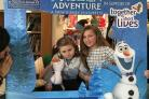 Sienna, left, with sister Ella at Helen & Douglas House's Frozen themed party.