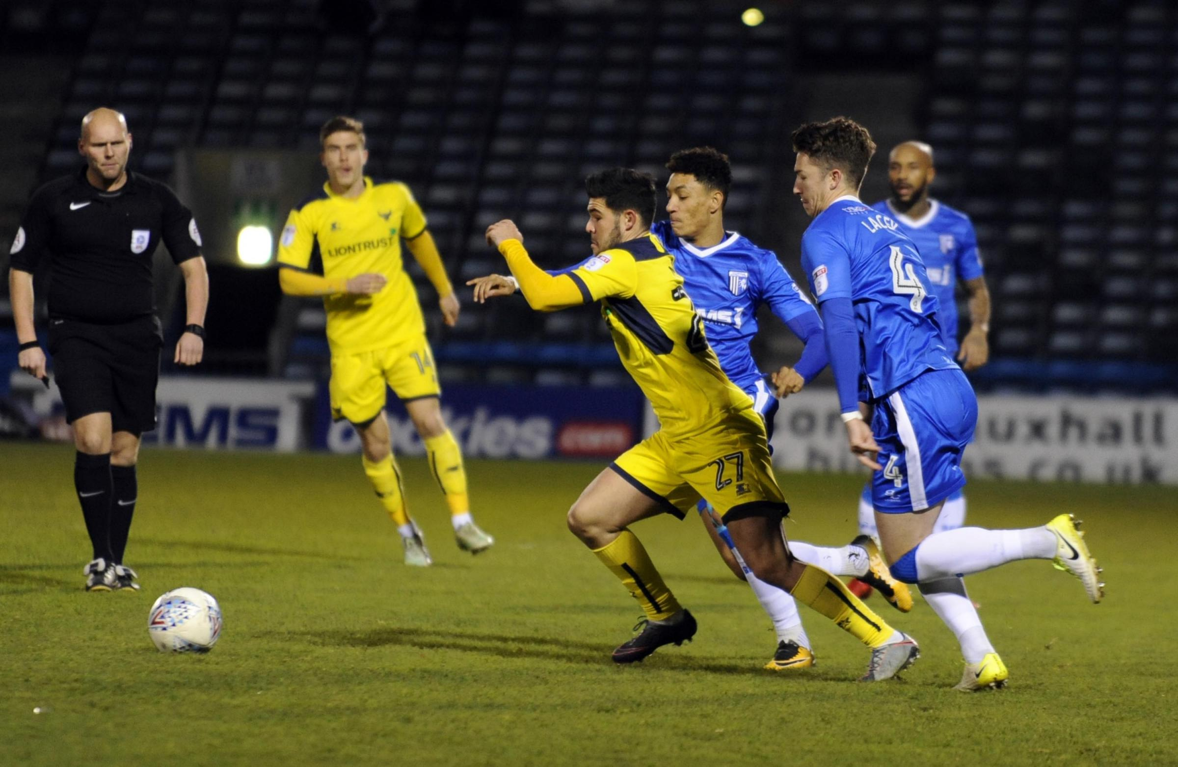 IMPACT: Alex Mowatt holds off two Gillingham players during Tuesday's Checkatrade Trophy tie, where he scored the winner Picture: David Fleming