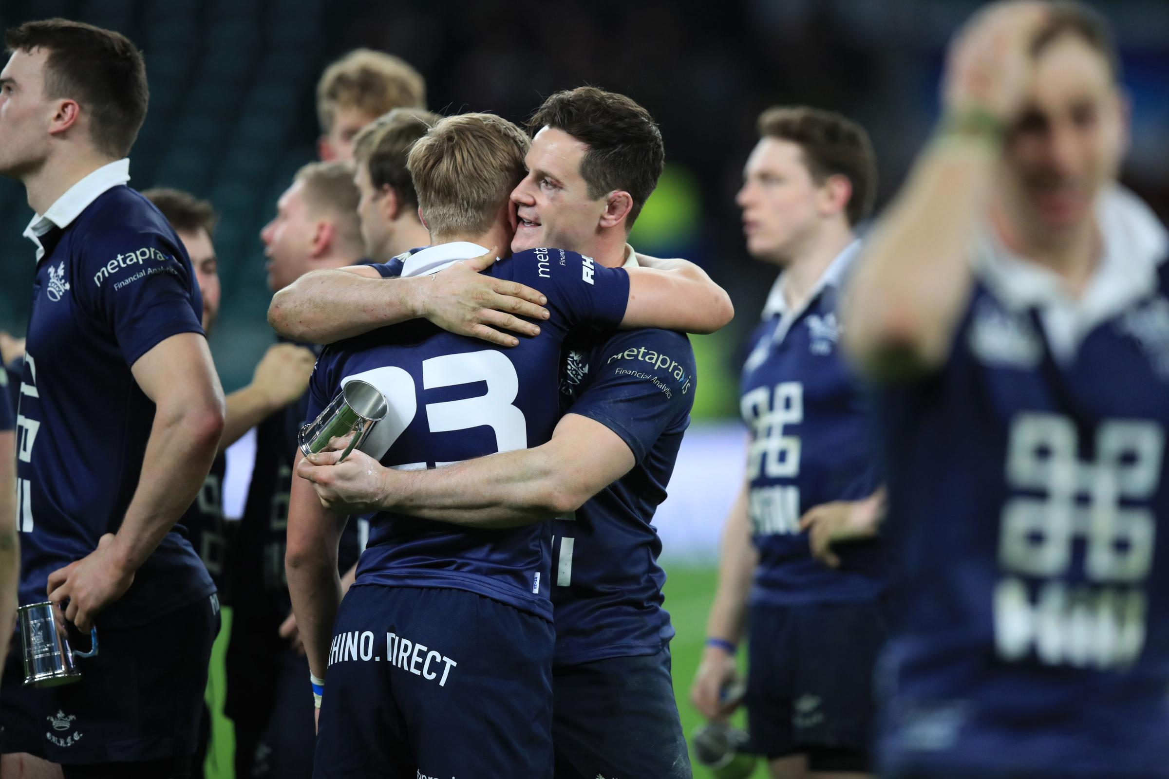 Flanker Andy Saull consoles Dan Barley after Oxford University's 20-10 defeat to Cambridge University in the 136th Varsity Match at Twickenham Picture: Mike Egerton/PA Wire
