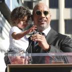Oxford Mail: Dwayne Johnson brought his baby daughter to the stage (Willy Sanjuan/AP)