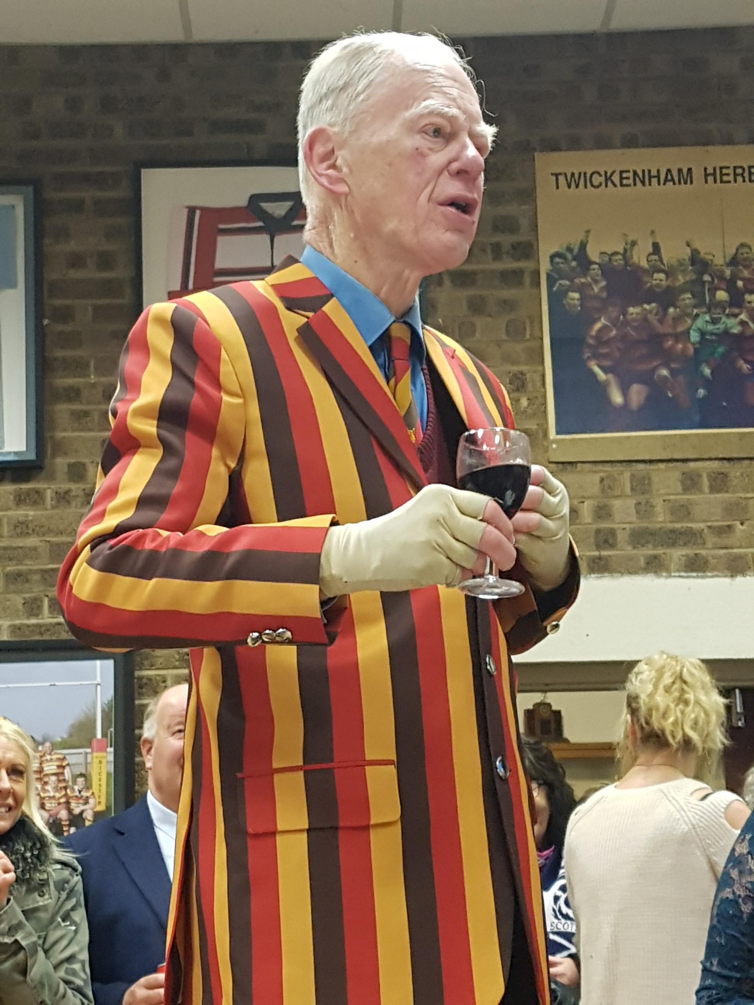 HONOUR: Paul Chrisp wears his new club blazer while giving a speech last Saturday