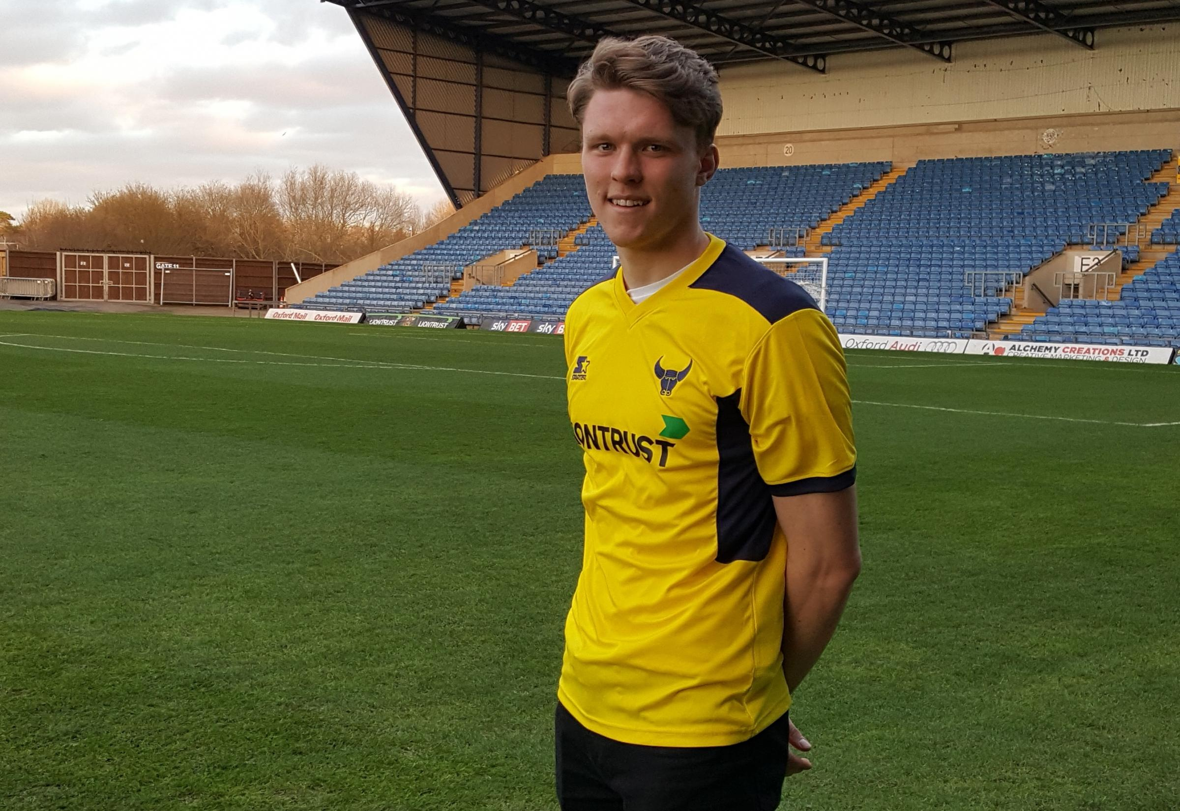 LONG-TERM DEAL: Rob Dickie is all smiles at the Kassam Stadium after signing a contract that will keep him at Oxford United until 2020 Picture: David Pritchard
