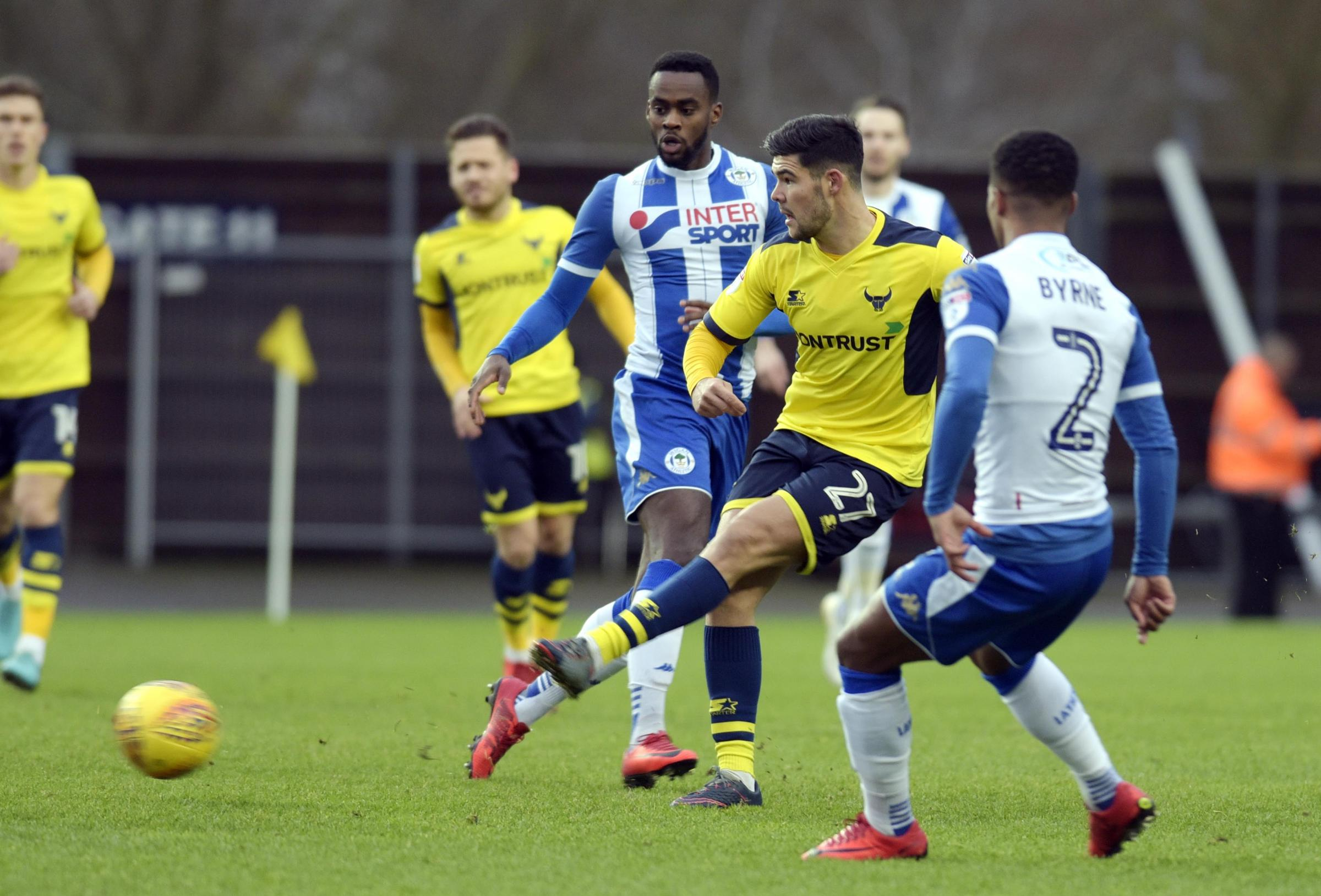 Alex Mowatt looks for an Oxford United teammate in the reverse fixture against Wigan Athletic last month, which the visitors won 7-0  Picture: David Fleming