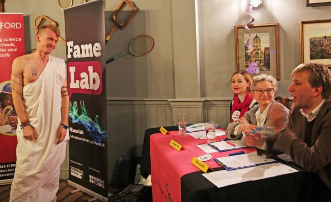 St Hugh's College maths tutor Tom Crawford gives his talk at the Famelab 2018 Oxford Heats. Picture: Autumn Neagle/ Science Oxford