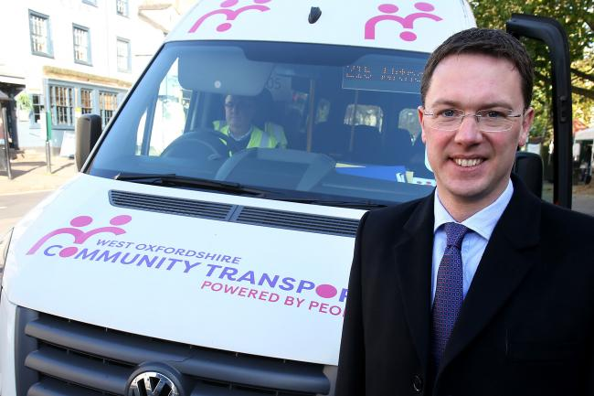 Witney MP Robert Courts pictured with one of West Oxfordshire Community Transport Ltd's buses in Market Square, Witney Picture: Ric Mellis.