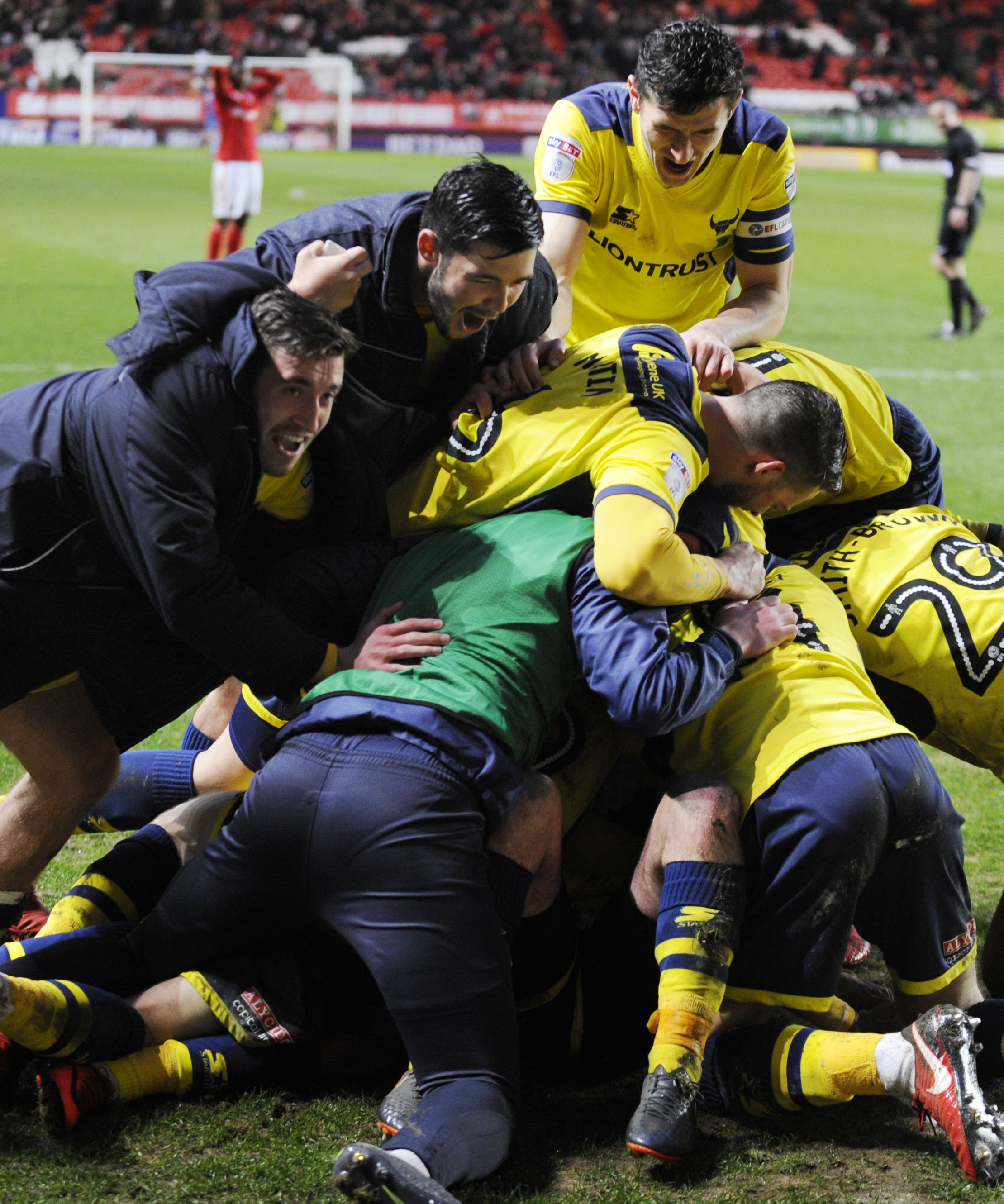 FEELGOOD FACTOR: Joe Rothwell (left) races to join in the Oxford United celebrations at Charlton after Ryan Ledson's injury-time winnerPicture: David Fleming
