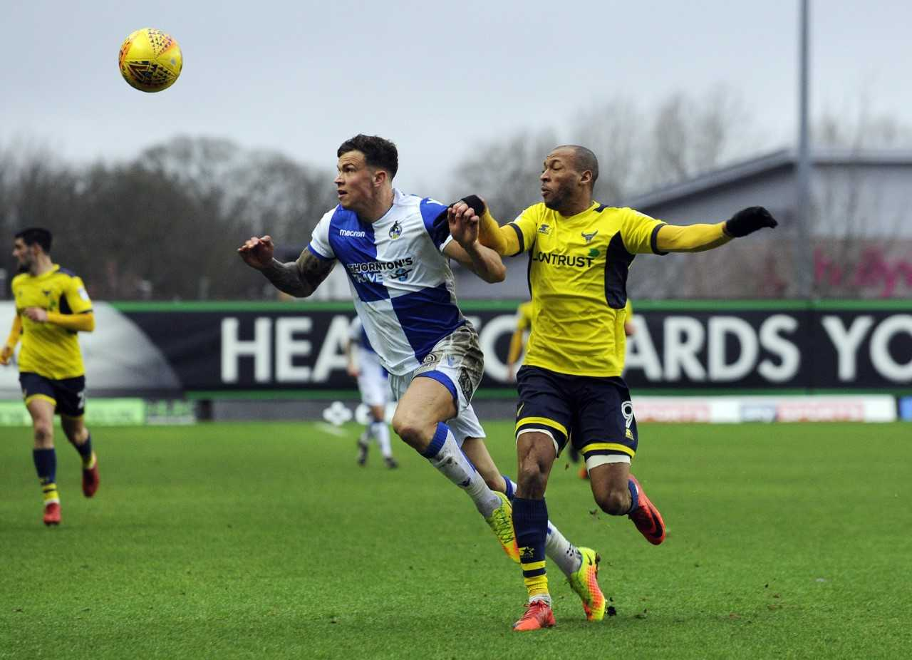 Wes Thomas (right) puts Bristol Rovers defender Tom Broadbent under pressure   Picture: David Fleming