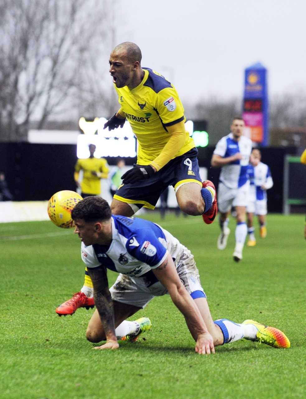 Wes Thomas puts Bristol Rovers defender Tom Broadbent under pressure   Picture: David Fleming