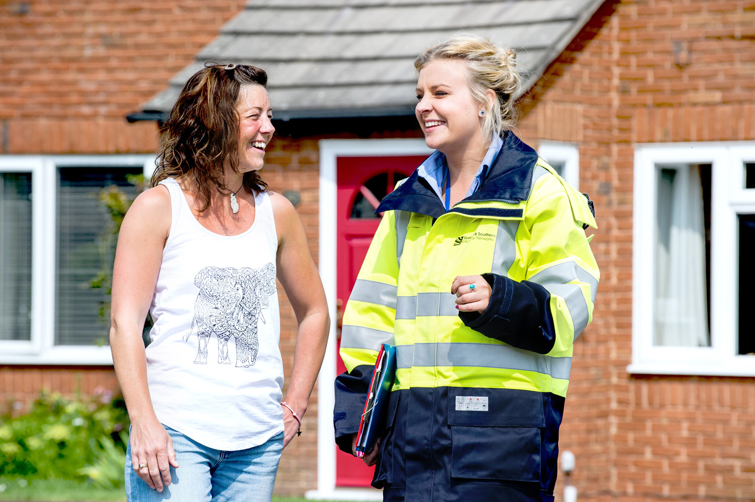 Jasmine Myhill reassuring local residents who live close to the new underground power cable extension building project, Lee-on-Solent. Pic: Stuart Nicol Photography