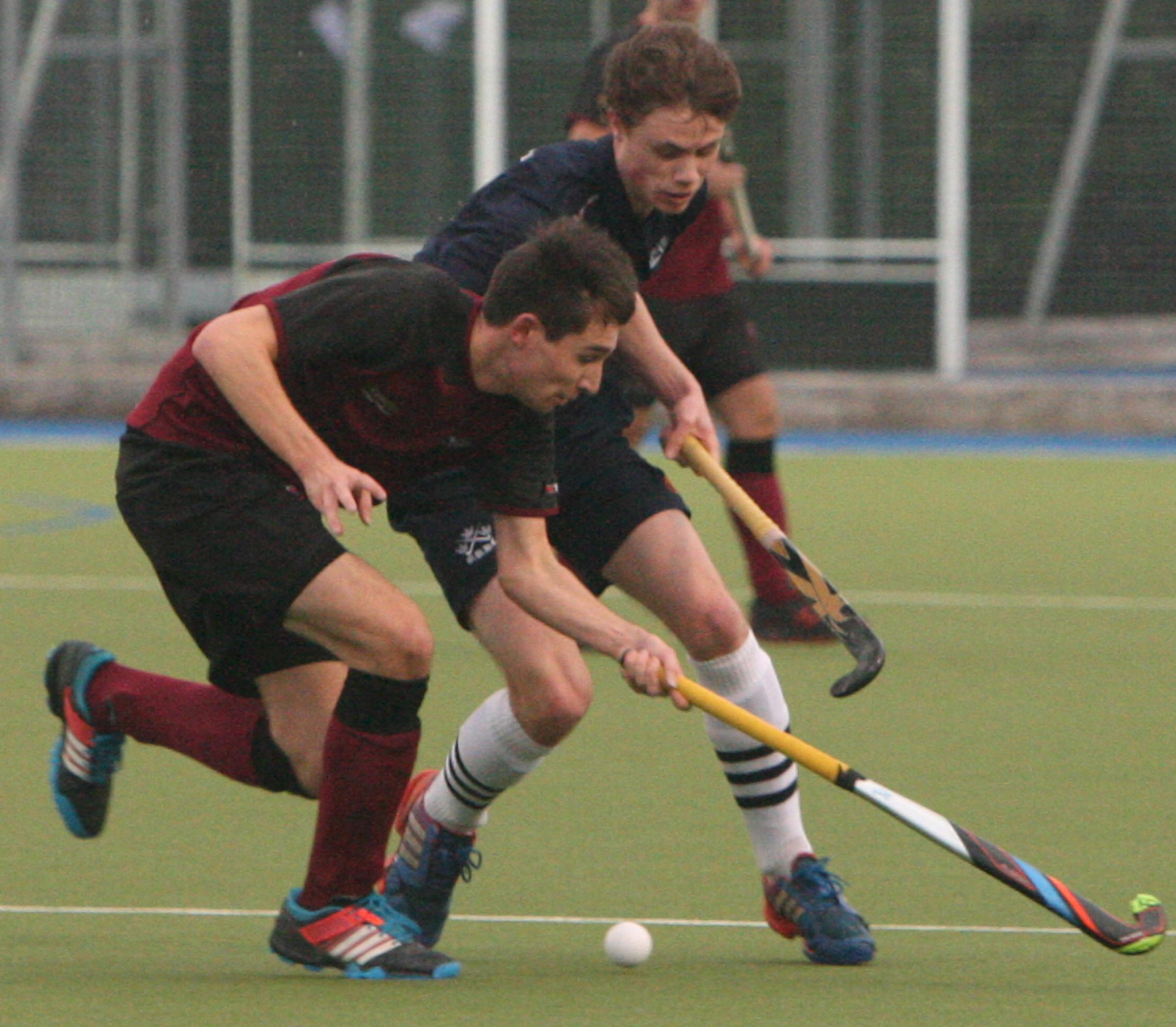 ON TARGET: Rob Dunnill (front) scored a rare goal for Oxford Hawks in their 4-1 victory over Henley