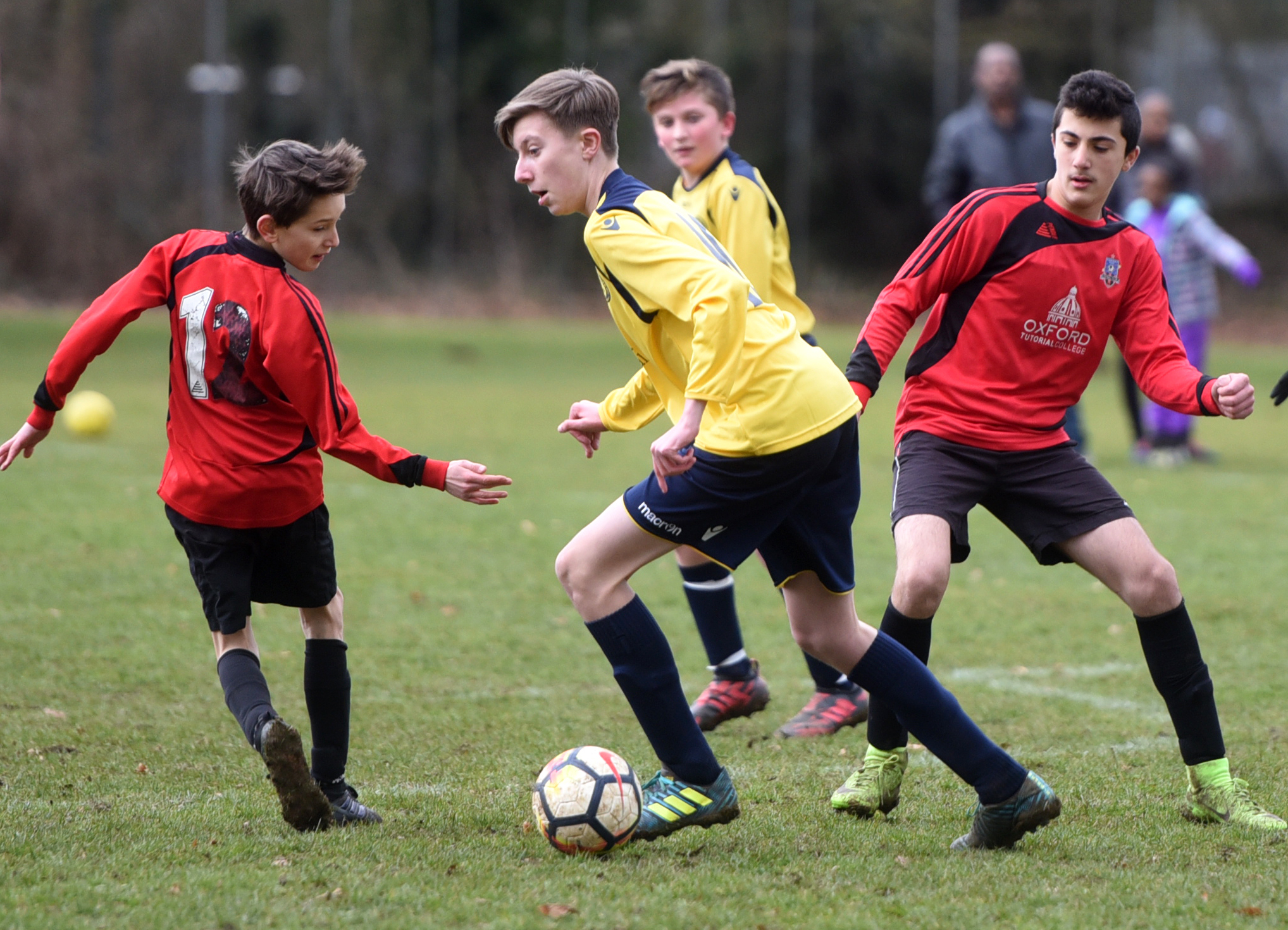 IN A SPIN: Hinksey Park's Poldi Czermark (left) is sent the wrong way by the run of Liam Jones during his side's 1-0 defeat by Bodicote Sports in the Under 13 Winter/Spring B League Pictures: Richard Cave