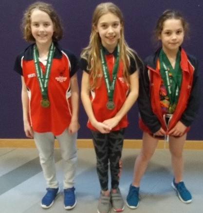 MEDALLISTS: City's nine-year-olds (from left) Jessica Bagley, Scarlett Shorter and Zofia Conway