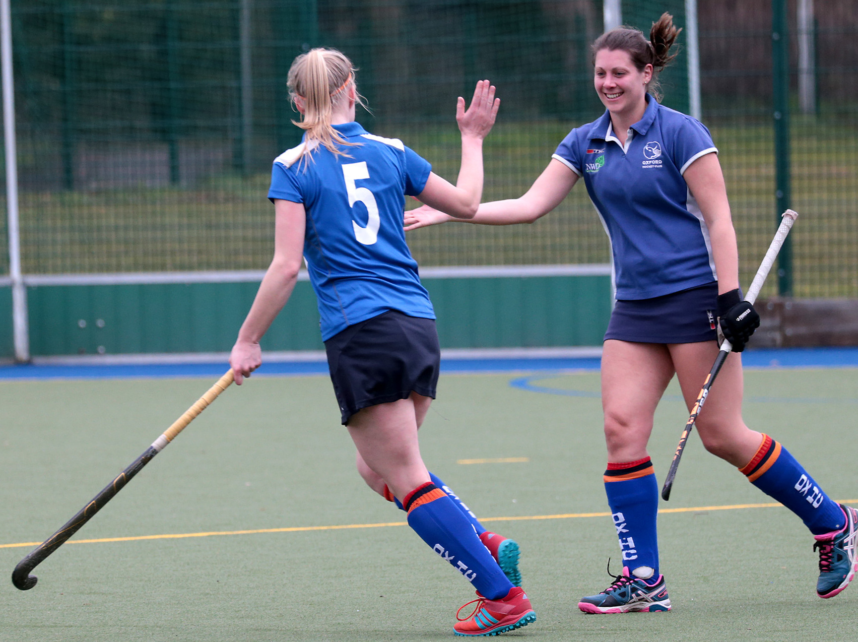 CELEBRATION: Floor Timmer (left ) is congratulated by Kim Warman after scoring during Oxford 3-2 victory over Southgate 2nd, while teammate Olivia Strickland (right) makes a quick break                                                  Pictures: Ric Mellis