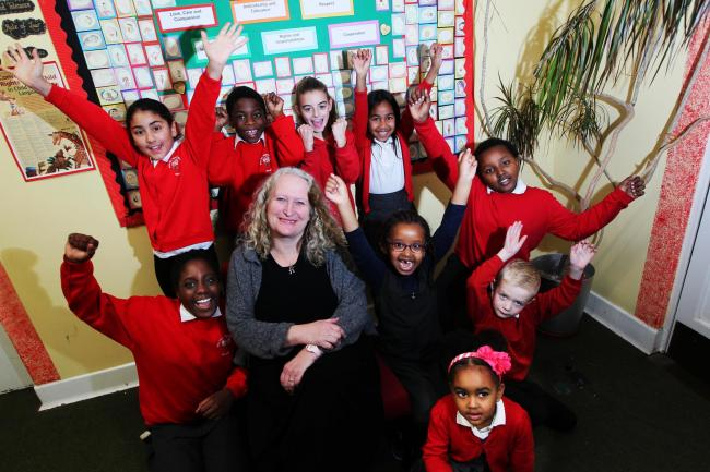 NEW ERA: Rose Hill pupils pictured in November after a positive Ofsted report, with headteacher Sue Vermes (middle). Picture by Ed Nix