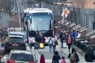 Buses wait to carry expelled diplomats from the US Embassy in Moscow (Pavel Golovkin/AP)