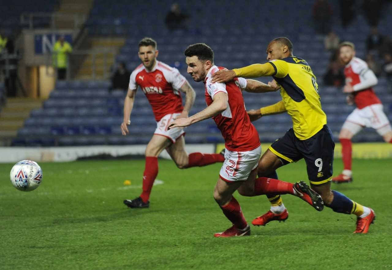 Wes Thomas (right) puts Lewie Coyle under pressure  Picture: David Fleming