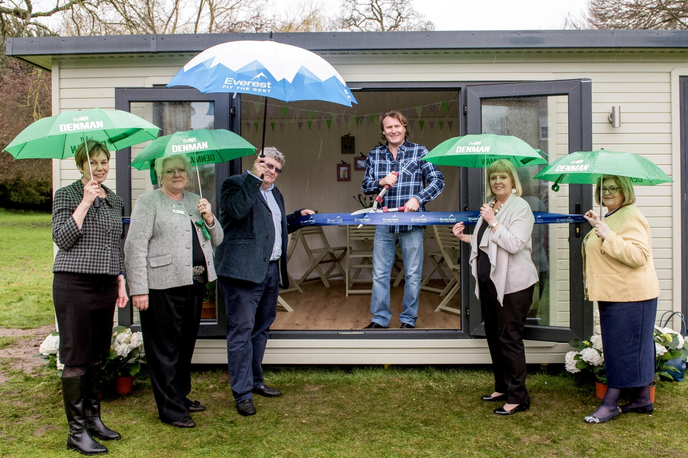 TV presenter David Domoney cuts the ribbon on the new Denman College garden room on April 9, 2018, with, left to right, Head of Denman Jane Dixon, NFWI board member Jeryl Stone, Everest marketing director Martin Troughton and NFWI board members Sue Wilson