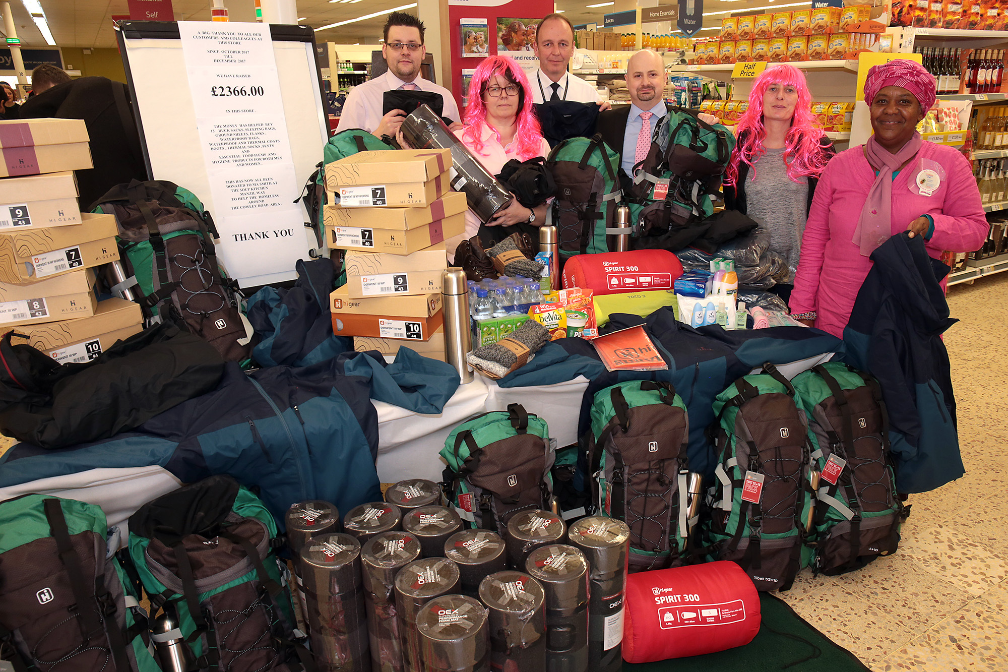 EFFORTS: Tesco staff with equipment paid for by customers' contributions for the homeless, alongside Tesco Turns Pink Cancer Research UK fundraiser at the Cowley Road Metro store                Picture: Ric Mellis