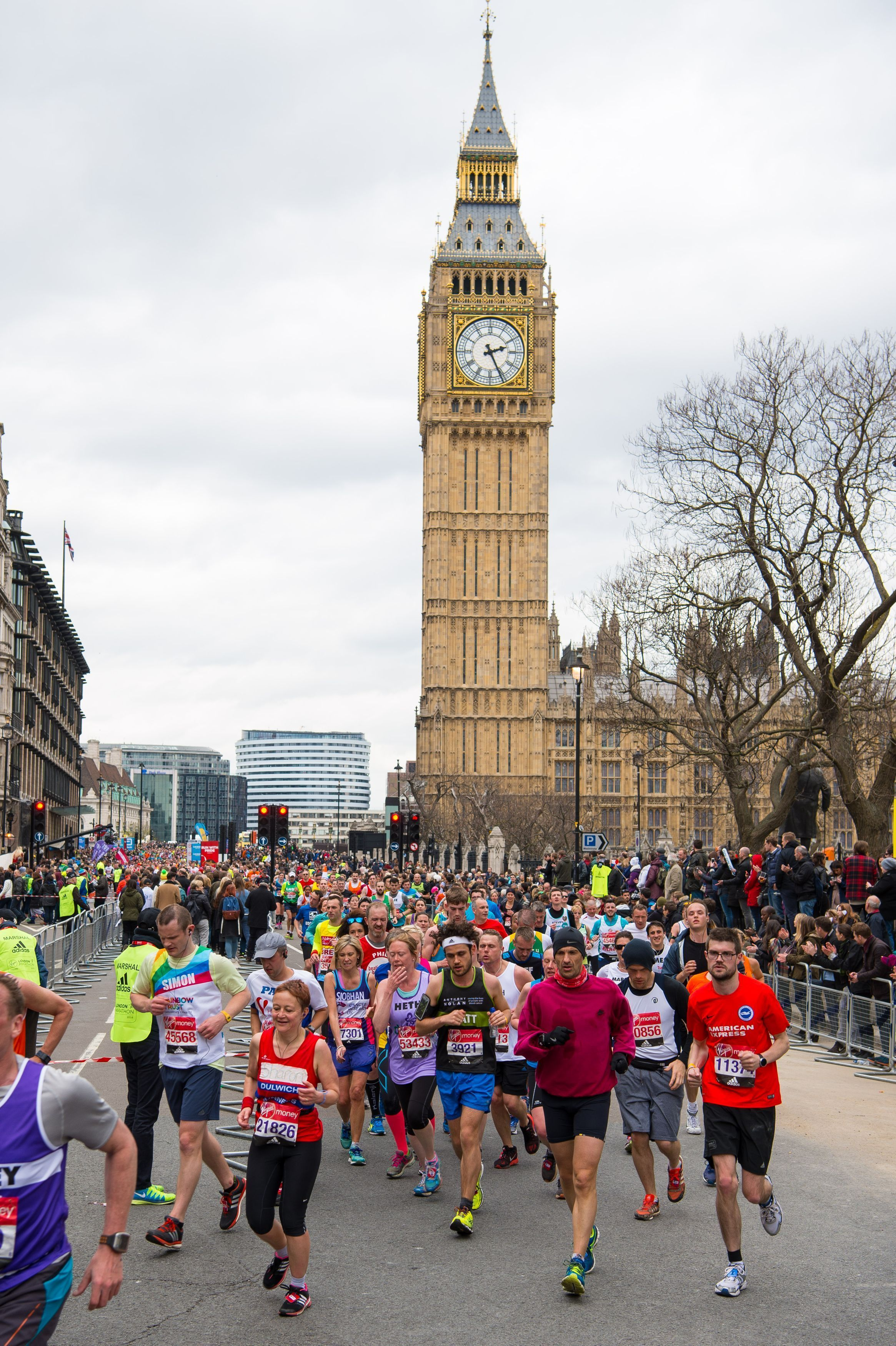Runner pass through Parliament Square during the 2016 Virgin Money London Marathon. PRESS ASSOCIATION Photo. Picture date: Sunday April 24, 2016. See PA story ATHLETICS Marathon. Photo credit should read: Dominic Lipinski/PA Wire.