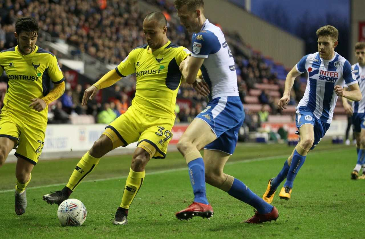 Gino van Kessel holds off a challenge against Wigan Athletic  Picture: Richard Parkes