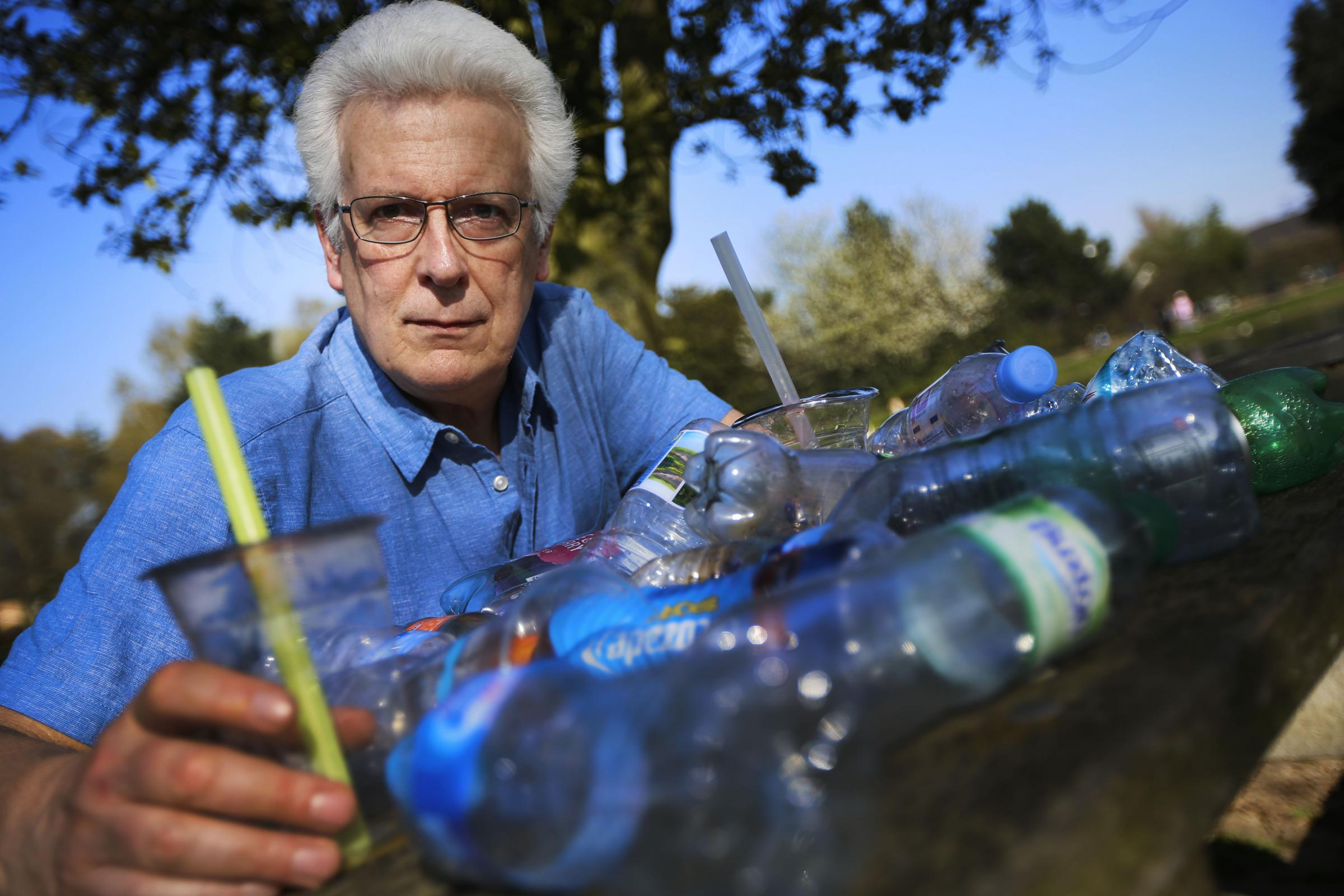 Chris Church of Friends of the Earth Oxford with a pile of needless plastic waste at Hinksey Park. Picture: Ed Nix