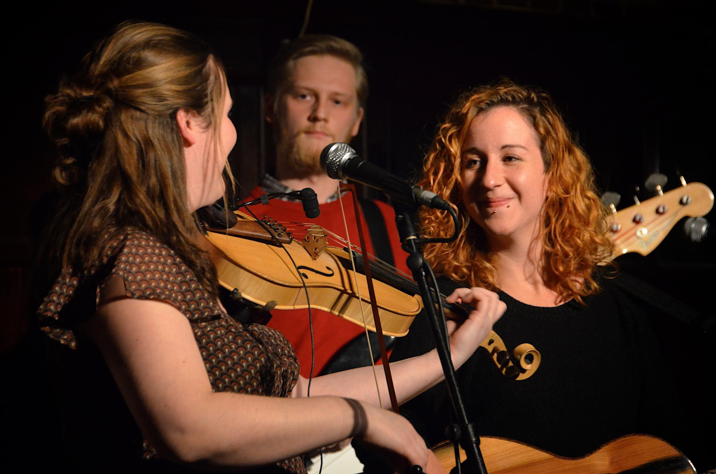 Knees-up: Wallingford's Jackie Oates performing with Oxford's Megan Henwood and Pete Thomas