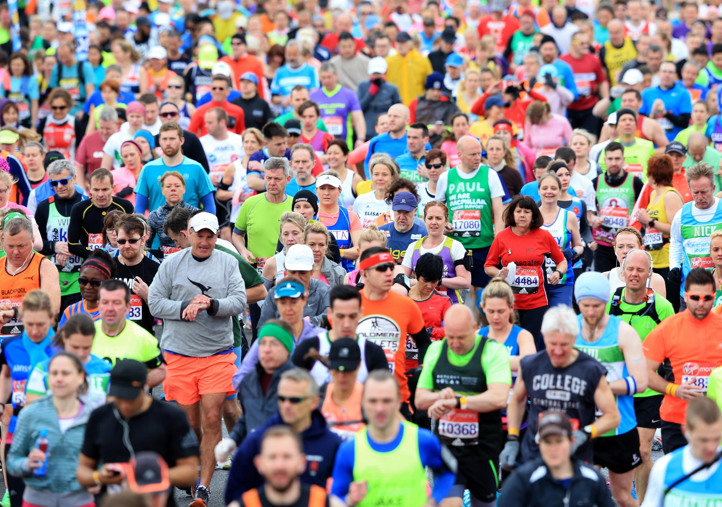 Runners make their way over the start line during the 2016 Virgin Money London Marathon..