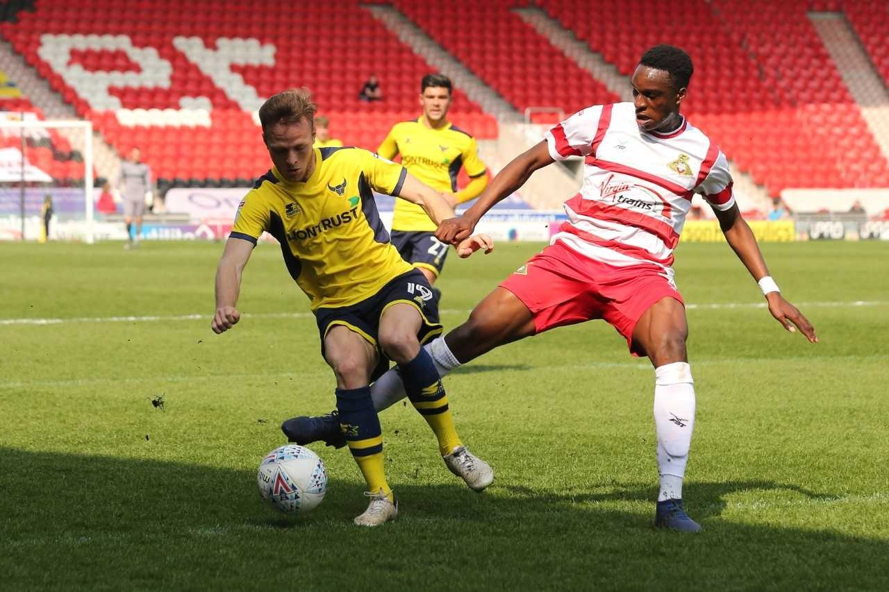 Todd Kane (left) gets forward for Oxford United at Doncaster Rovers  Picture: James Williamson