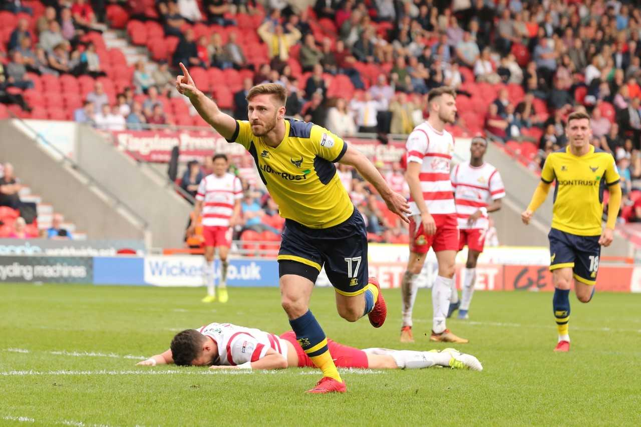James Henry celebrates scoring Oxford United's winner at Doncaster Rovers  Picture: James Williamson