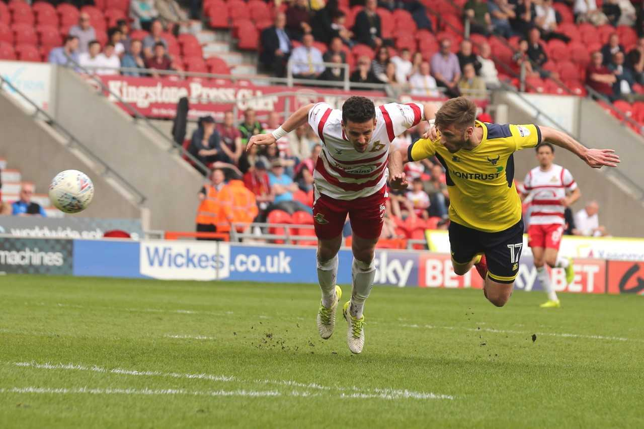 James Henry dives to head in Oxford United's winner at Doncaster Rovers  Picture: James Williamson