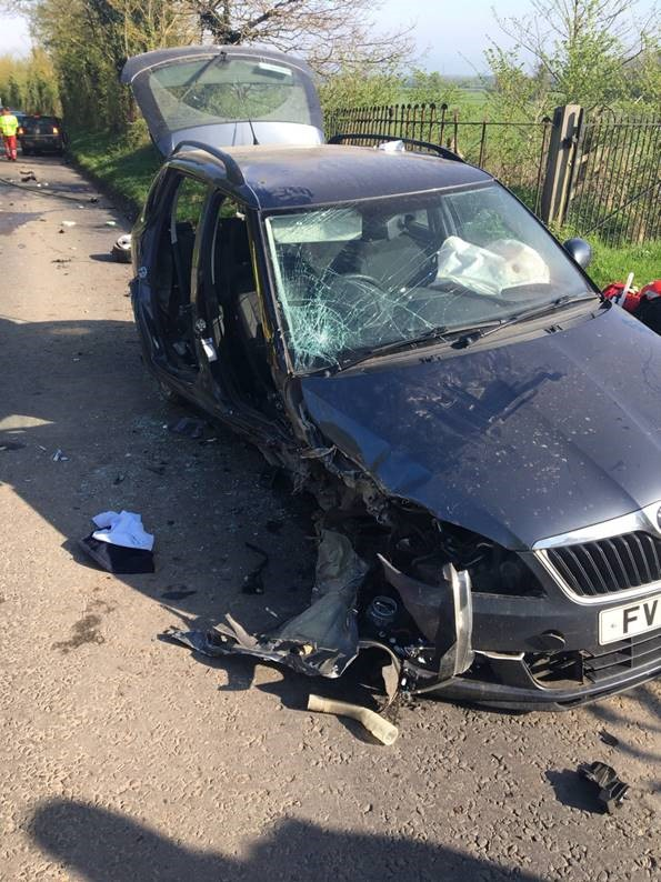 Elderly woman cut free by fire fighters after two-car smash