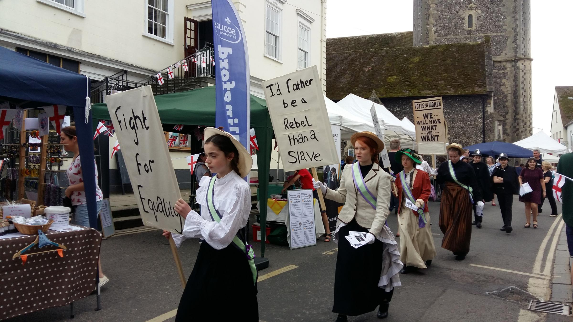 'Suffragettes' march through Wallingford Market Place. Picture: Andy Ffrench