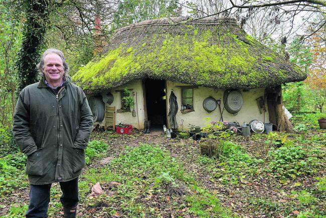 Wolvercote resident Michael Buck shows off the house he built at an undisclosed location in Oxfordshire
