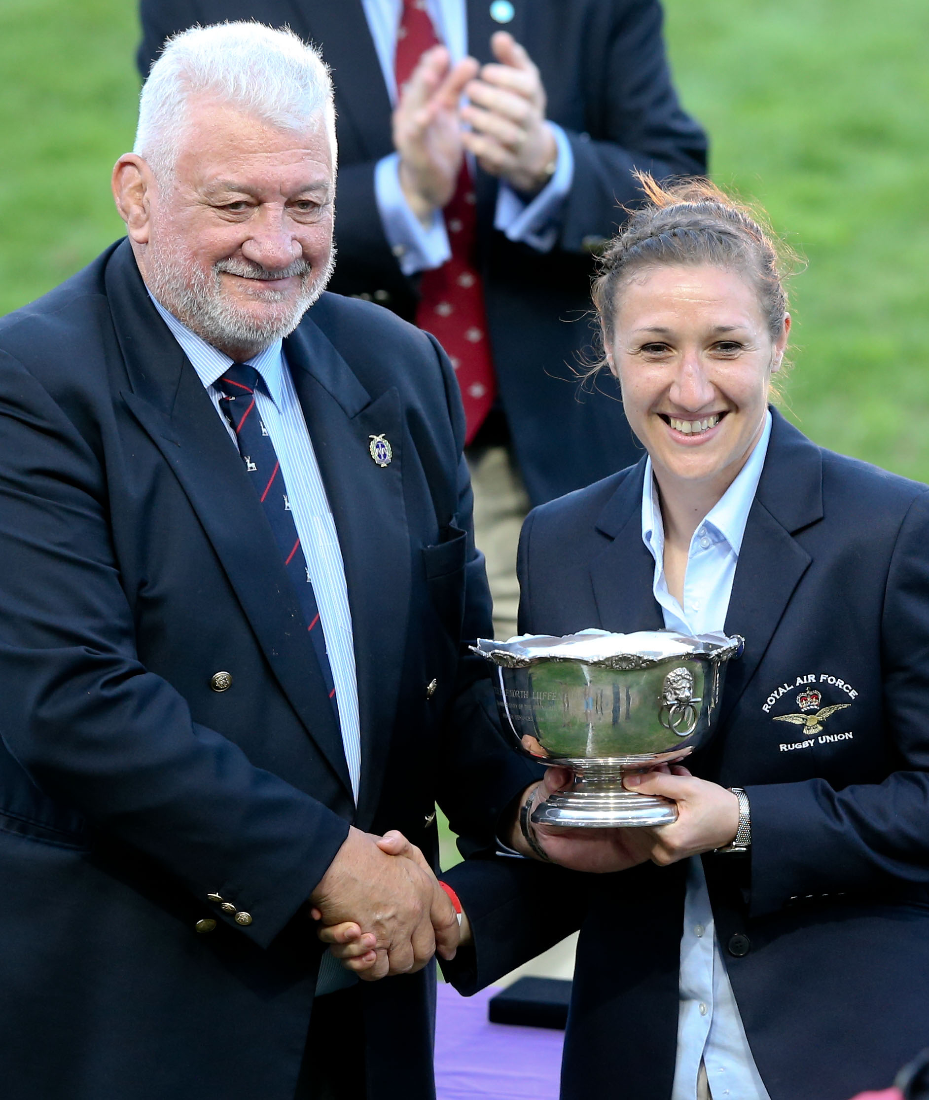 Nigel Rose, left, presents the Molly Rose Trophy to Flight Lieutenant Chrissy Siczowa. Pic Alligin Photograpghy